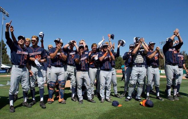 Titan Baseball players salute fans after the Long Beach Super Regionals