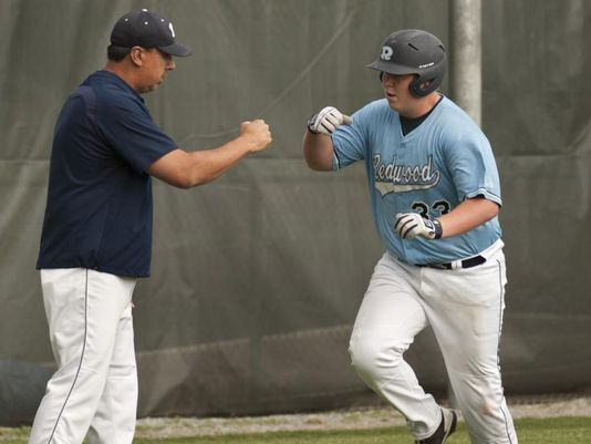 Jace Chamberlin heads for home and gets a fist bump from third base coach after another home run.