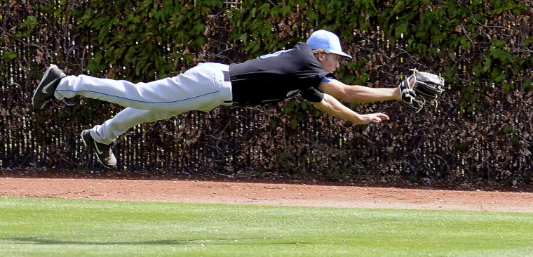 Mitch Berryhill lays out for a diving catch while playing in Junior College