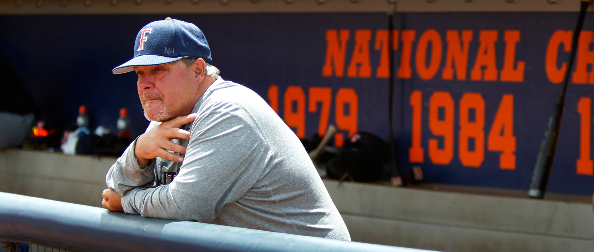 Cal State Fullerton baseball coach Rick Vanderhook watches the team run through drills at Cal State Fullerton's Goodwin Field.
