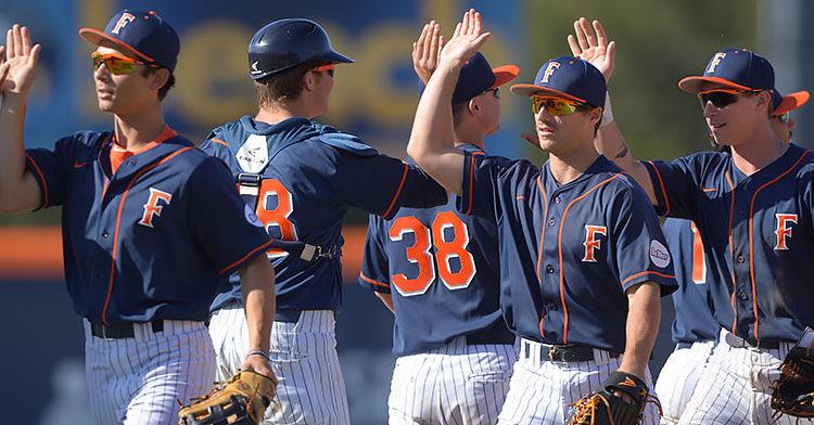 Titan baseball players high five after a win