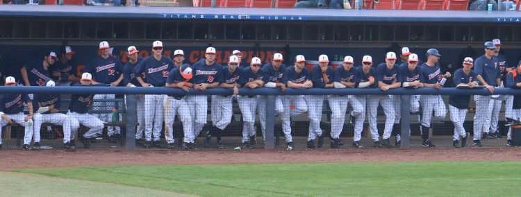 Cal State Fullerton Titan baseball dugout players looking dejected