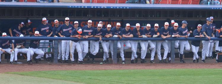 Cal State Fullerton Titan baseball dugout players looking dejected