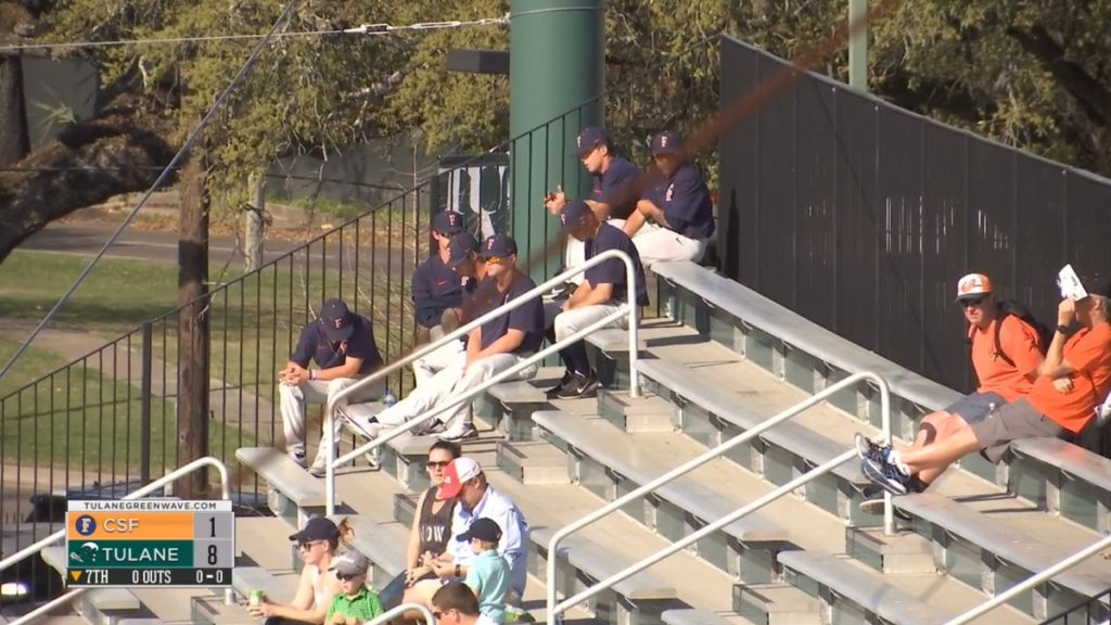 Seven Titan Baseball players sit in the 1st base bleachers after being suspended for Sunday's game for missing curfew.