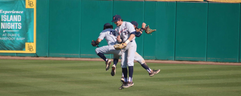 outfielders celebrate